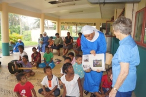 Pauline presents historical photos she took 40-years ago as a gift to the Nuns