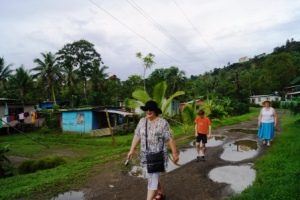 Walking through the squatter village and dodging the puddles from the downpours!