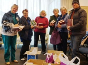 Some of the Children's story books, theological books, and prayer books donated from the Nelson Diocese, being packed for team members to take in their bags to Fiji