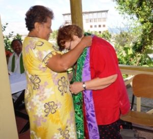 Rev Amy Chambers presents a set of Polynesian Shawls to Rev Wendy Robinson for Archer
