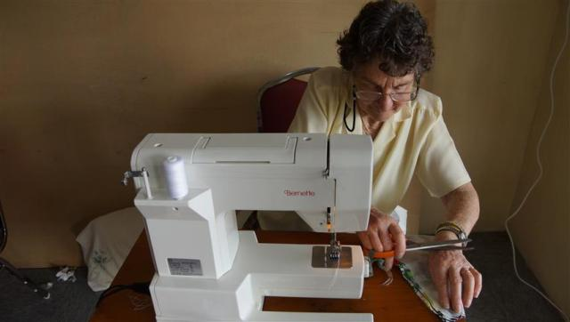 Golden Oldie Jill hard at it sewing the bula dresses for the girls