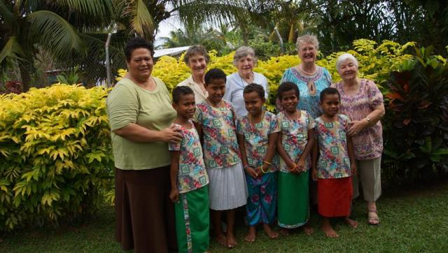 The girls in their beautiful bula sulu's and blouses, with the Golden oldies sewing team with them
