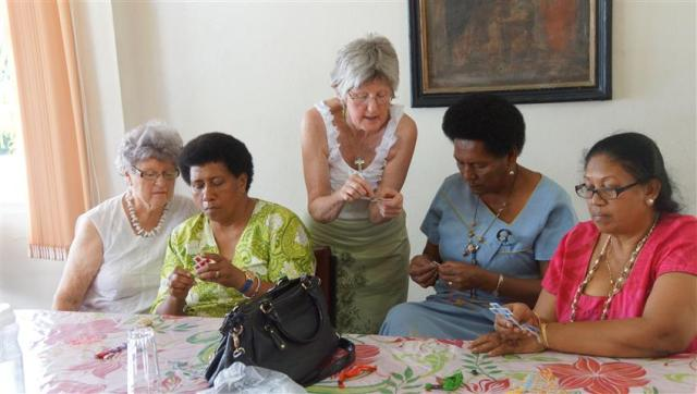 Helen and Elaine teach the ladies making the embroidered crosses at the woman's workshop