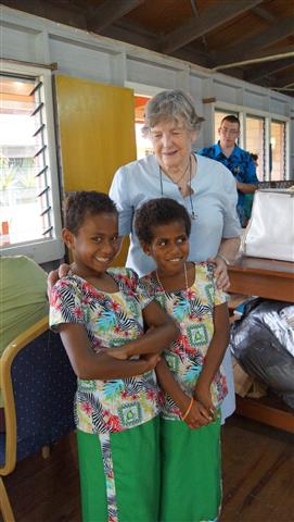 Our 'Lady Elizabeth' who oversaw the sewing project enjoys seeing the final girls uniforms being paraded by the girls at the orphanage