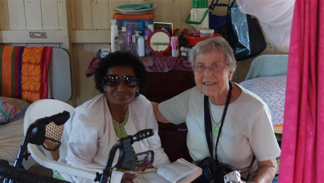 """I read the bible everyday"", Mary discusses a scripture with the resident at the Senior Citizen's Home"