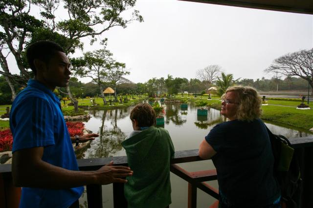 Bible College student Moses explains to Luke and Adele about the Fijian reserve they visited