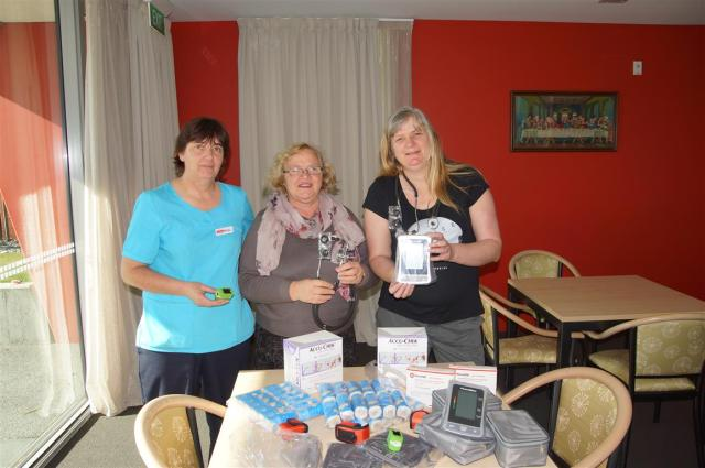 Anita, Adele, Mel display some of the medical items purchased for the remote health centres team members will be assisting at.